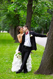 Bride and groom in park Stock Photo