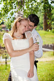 Bride and groom in park Royalty Free Stock Photography