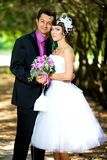 Bride and groom  in the park Royalty Free Stock Photos