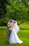 Bride and groom in park Royalty Free Stock Image