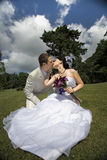 Bride and groom in the park kising Royalty Free Stock Photography