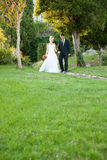 Bride and groom in a park outdoor Stock Images