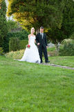 Bride and groom in a park outdoor Royalty Free Stock Photo