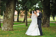 Bride and Groom in a park - outdoor portrait Stock Photo