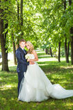 Bride and groom in park summer  outdoor. Stock Photo