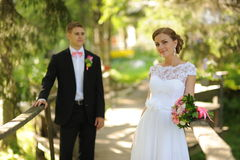 Bride and groom in park Stock Images