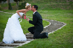 Bride and groom on a path through park Stock Photo