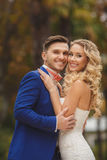 The bride and groom - the photograph in the Park. Stock Images