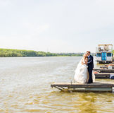 Bride and groom on pier. Wedding couple Royalty Free Stock Photography