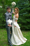 Bride and groom with pigeons Royalty Free Stock Images