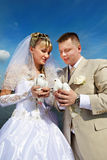 Bride and groom with pigeons Royalty Free Stock Photos