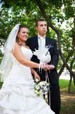 Bride and groom with pigeons Royalty Free Stock Photography