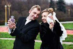 Bride and groom with pigeons on hands Royalty Free Stock Photos