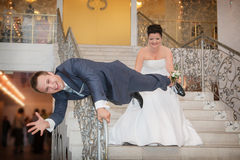 Bride and groom play the fool on ladder Stock Photos