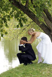 Bride and groom playful in love Royalty Free Stock Photography