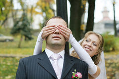 Bride and groom playing Royalty Free Stock Photo