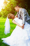 Bride and groom playing in park instagram stile Stock Image