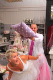 Bride and groom playing with pillow Stock Photo