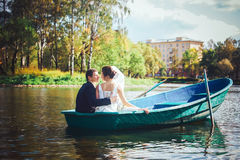 Bride and Groom in the Pleasure Boat Royalty Free Stock Image