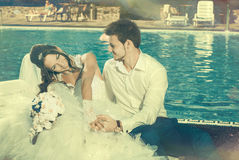 Bride and Groom at pool Stock Photos