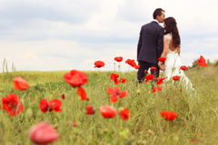 Bride and Groom in poppy fields Royalty Free Stock Photos