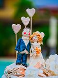 Bride and Groom porcellain decoration top cake hearts. Bride and Groom porcellain decoration top of the cake hearts stock image