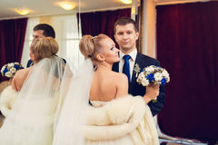 Bride and groom portrait in the hotel luxury room.  Royalty Free Stock Images