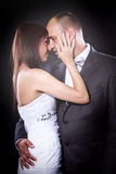 Bride and groom portrait over black Stock Images