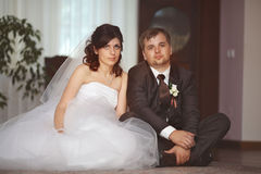 Bride and groom portrait in  room Royalty Free Stock Photography