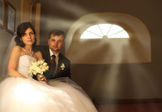 Bride and groom portrait in  room Royalty Free Stock Photos