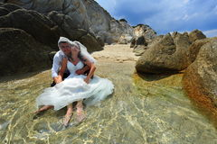 Bride and groom portrait - trash the dress Royalty Free Stock Images