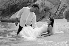 Bride and groom portrait - trash the dress Stock Image