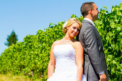 Bride and Groom Portraits. A bride and groom pose for portraits on their wedding day at a winery vineyard outdoors in oregon Royalty Free Stock Image