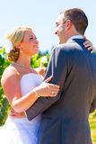 Bride and Groom Portraits. A bride and groom pose for portraits on their wedding day at a winery vineyard outdoors in oregon Stock Images