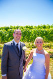 Bride and Groom Portraits. A bride and groom pose for portraits on their wedding day at a winery vineyard outdoors in oregon Stock Image