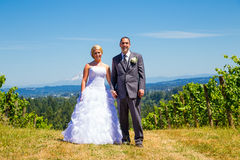 Bride and Groom Portraits. A bride and groom pose for portraits on their wedding day at a winery vineyard outdoors in oregon Stock Photo