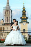 Bride and groom posing in city Royalty Free Stock Image