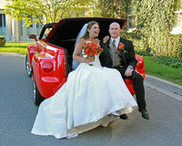 Bride and Groom Posing in Convertible Red Truck stock photography