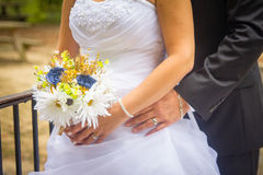 Bride and groom posing with flowers Stock Image