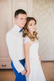 Bride and groom posing in a hotel room before ceremony Royalty Free Stock Image