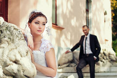 Bride and groom posing near castle Royalty Free Stock Image