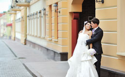 Bride and groom posing in an old town - wedding couple Royalty Free Stock Photo