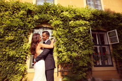 Bride and groom posing outdoors Royalty Free Stock Photo