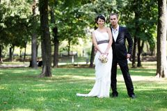 Bride and groom posing outdoors on wedding day Royalty Free Stock Images