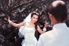Bride and groom posing in park Royalty Free Stock Image