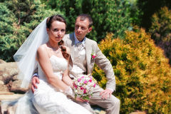 Bride and groom posing in park Stock Photo