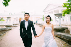 Bride and groom posing on the streets Stock Image