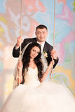 Bride and groom posing in the studio Royalty Free Stock Photos