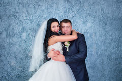 Bride and groom posing in the studio Stock Photos