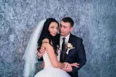 Bride and groom posing in the studio Royalty Free Stock Photography